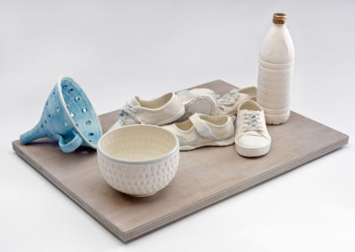 Water: CodeBlue - Children Without (2018), 10 1/2(h) x 22(w) x 16(d), glazed porcelain with gold luster, wood
