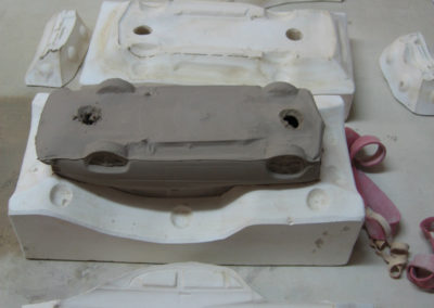Cast cars in mold