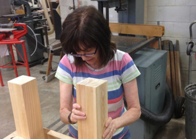 Assembling legs on the bench
