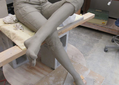 Clay figure being constructed