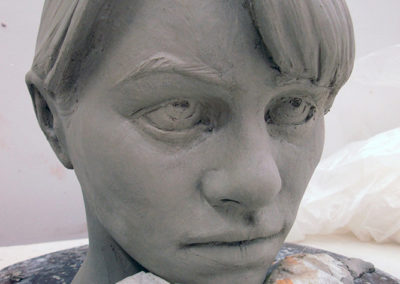 Clay figure being constructed - head and face detailed