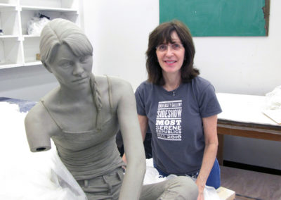 Clay figure being constructed - head attached
