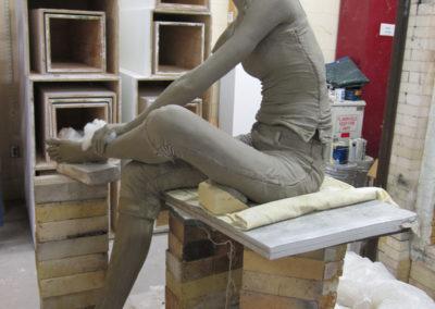 Clay figure loaded in gas car kiln